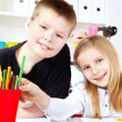 Two small children in school - Stock Photo