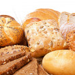 Assortment of baked bread over white — Stock Photo