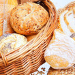 Assortment of baked bread in the basket — Stock Photo