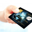 Closeup of blue credit card holded by hand — Stock Photo