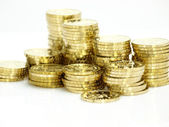 Gold towers made out of gold coins — Stock Photo