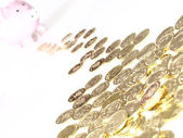 Many of gold coins making curved path — Stockfoto