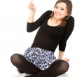 Cheerful girl pointing up — Stock Photo
