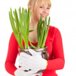 Cheerful woman with plant in pot — Foto de Stock