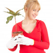 Happy woman with pot of flower — Stock Photo