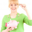 Woman with euro and piggy bank — Stock Photo #11049726