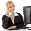 Calling business woman with computer — Stockfoto