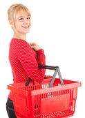 Young woman with shopping basket — Stock Photo