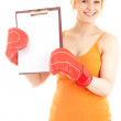 Woman with clipboard wearing boxing gloves — Stockfoto