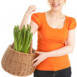 Young woman with plant in basket — Stock Photo
