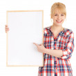 Woman pointing at blank poster — Stock Photo