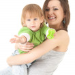 Stock Photo: Young mother cuddling son