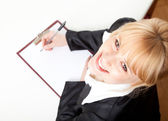Writing female student or businesswoman — Stock Photo