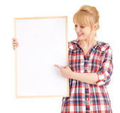 Woman showing someting at blank poster — Stok fotoğraf