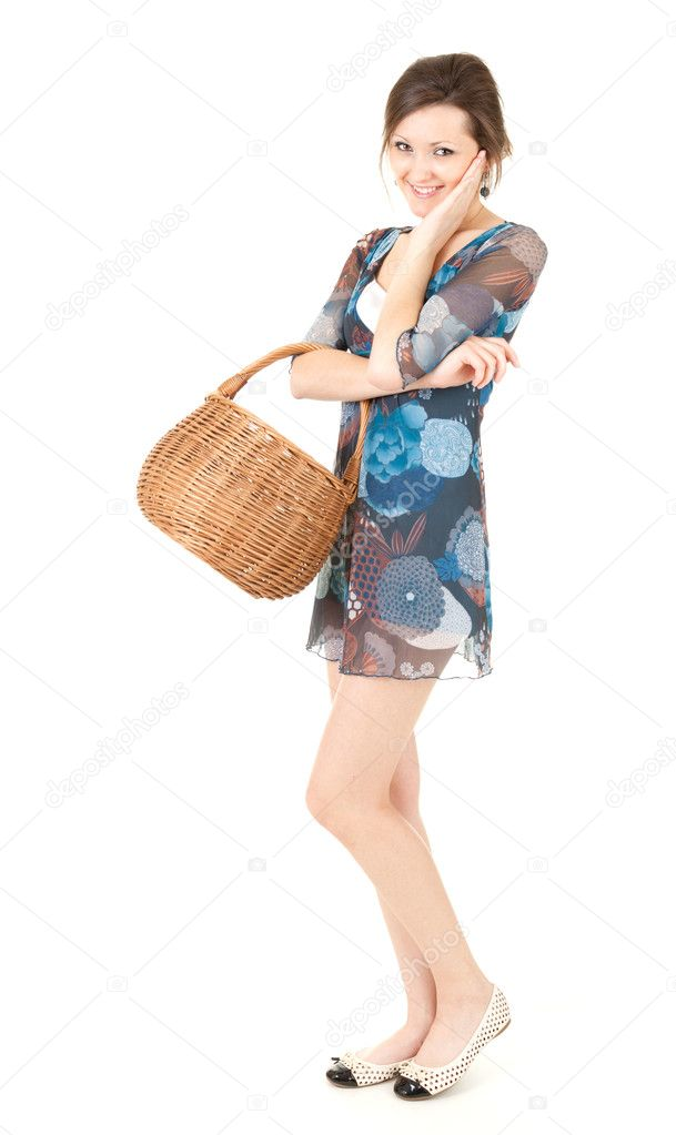 Beautiful teenage shopping girl with wicker basket, full length, white background — Stock Photo #11050555