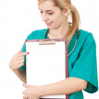 Female doctor with clipboard - Stock Photo