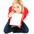 Young woman with clipboard - Stock Photo