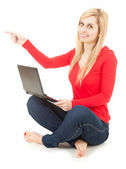 Woman with laptop showing something — Stock Photo