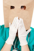 Ashamed doctor with bag on head — Stock Photo