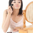 Beautiful young woman havin make up — Stock Photo