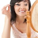 Beautiful young woman with mascara — Stock Photo