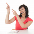 Pointing up woman with headset — Stock Photo