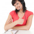 Woman with headset keeping thumb up — Stock Photo