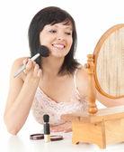 Beautiful young woman havin make up — Stock Photo