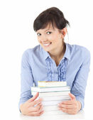 Student woman with books smiling — Stock Photo