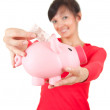 Woman with euro in piggy bank — Stockfoto