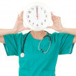 Doctor with a big clock — Stock Photo