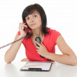 Lady secretary speaking on the phones - Stock Photo