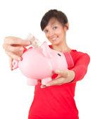 Mujer con el euro en la hucha — Foto de Stock