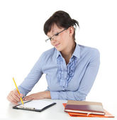 Businesswoman with clipboard and pen — Stock Photo