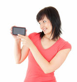 Young woman holding smartphone — Stock Photo