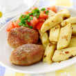 Meat cutlets with potato dumplings — Stock Photo #11271956