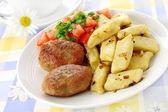 Meat cutlets with potato dumplings — Stock Photo