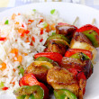 Fried skewers with rice — Stock Photo