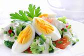 Salad with broccoli, tomato, egg and garlic sauce — Stock Photo
