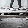 Legs in ruined room - Stock Photo