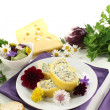 Cheese rolls with edible flowers — Stock Photo