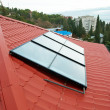 图库照片: Solar water heating system.