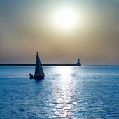 Sail boat against sunset — Stock Photo