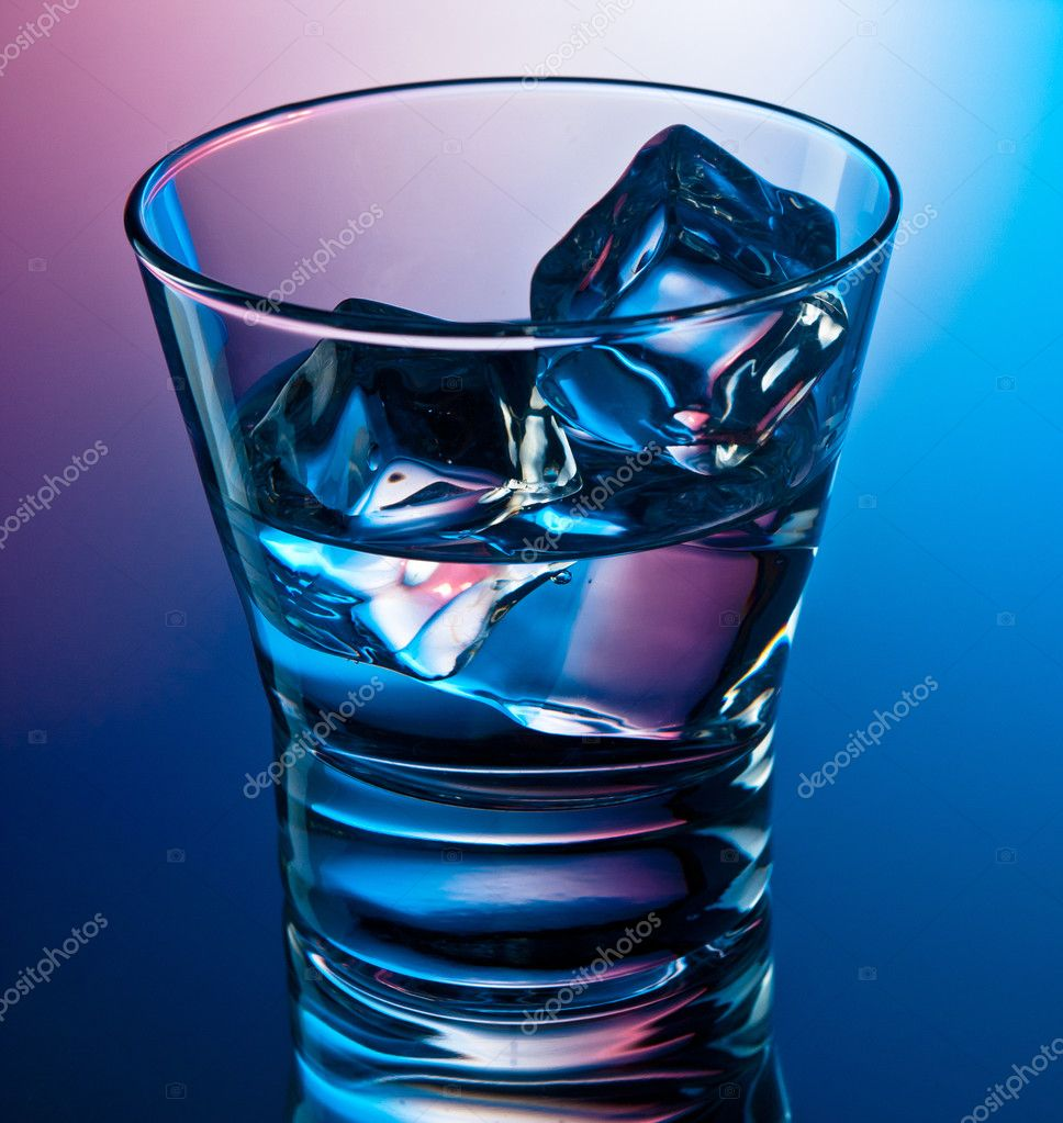 Glass of clear drink on the rocks — Stock Photo #10968500