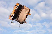 Flying luggage — Stock Photo