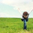 Young boy playing in a field — Stock Photo #11407311