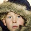 Little boy wearing a fur lined hood — Stock Photo