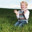 Little boy clapping his hands in glee — Stockfoto