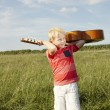 Small boy with wooden guitar — Stock Photo