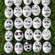 White eggs and many funny faces — Stock Photo #11225648